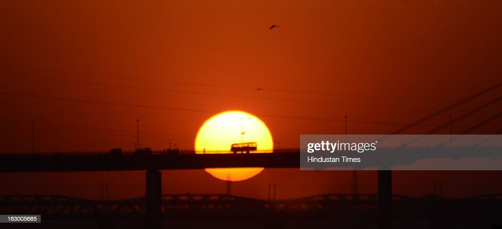 Sunset at Sangam in the Kumbh Mela area on March 3, 2013 in Allahabad, India. The mega religious fair, held once in 12 years, last official bathing on 'Maha Shivratri' on March 10, 2013.