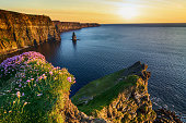 epic sunset at the cliffs of moher in county clare, ireland. beautiful evening scenic view from the wild atlantic way