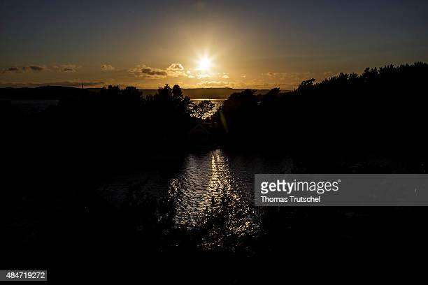Sunset at the coast and the sea at a fjord on July 06 2015 in Kristiansand Norway