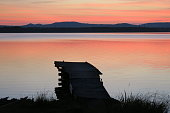 Sunset at the swedish lake Siljan outside the small town Mora in the county Dalarna. The village nearby is called Nusnäs.