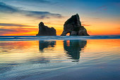 Sunset at Wharariki beach, West coast, South Island, New Zealand.
