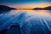 Sunset behind a boat in the San Juan Islands