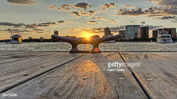 Sunset Behind a Dockside Cleat & River
