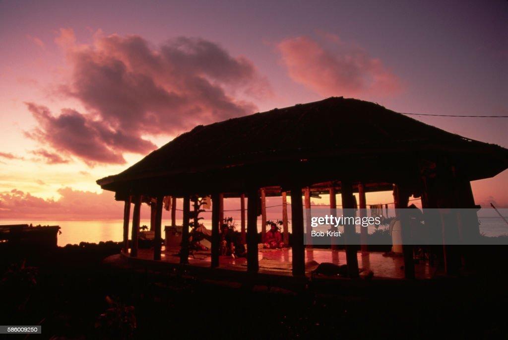 Sunset Behind Samoan House
