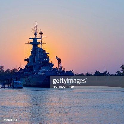 Sunset behind USS North Carolina