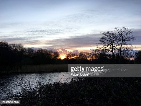 Sunset by the lake : Stock Photo