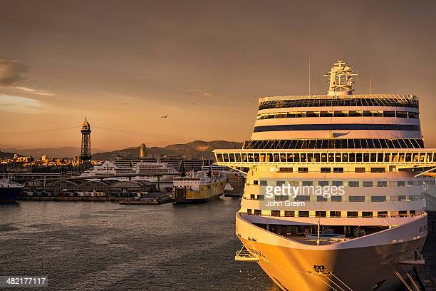 Sunset cruise ship docked in harbor