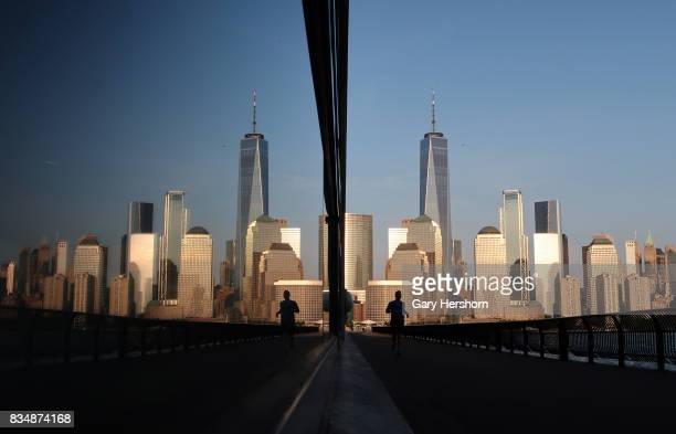Sunset falls on lower Manhattan and One World Trade Center in New York City on August 17 as seen from Jersey City New Jersey