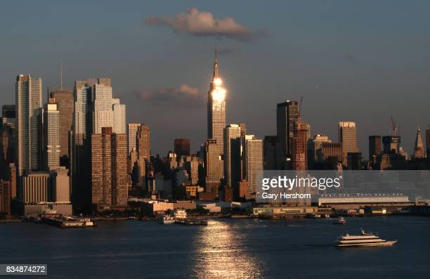 Sunset falls on lower Manhattan and the Empire State Building in New York City on August 16 as seen from Weehawken New Jersey