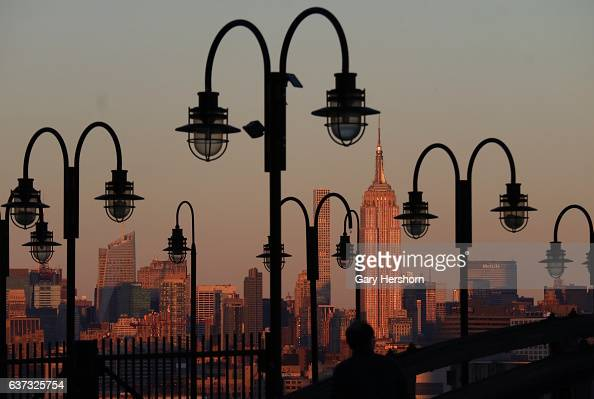 Sunset falls on midtown Manhattan and the Empire State Building in New York City on January 1 2017 as seen from Liberty State Park in Jersey City NJ