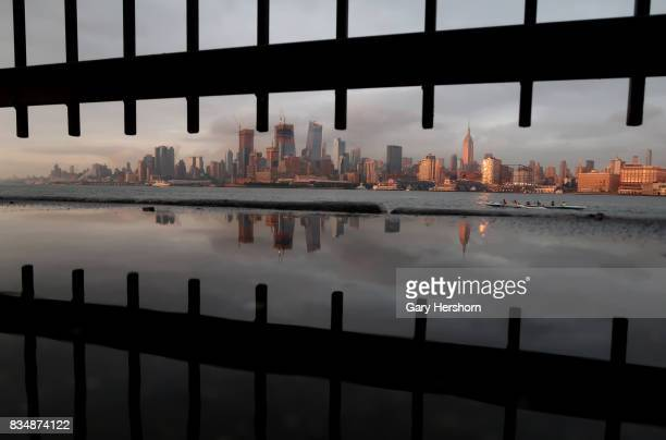Sunset falls on midtown Manhattan and the Empire State Building in New York City on August 15 as seen from Weehawken New Jersey