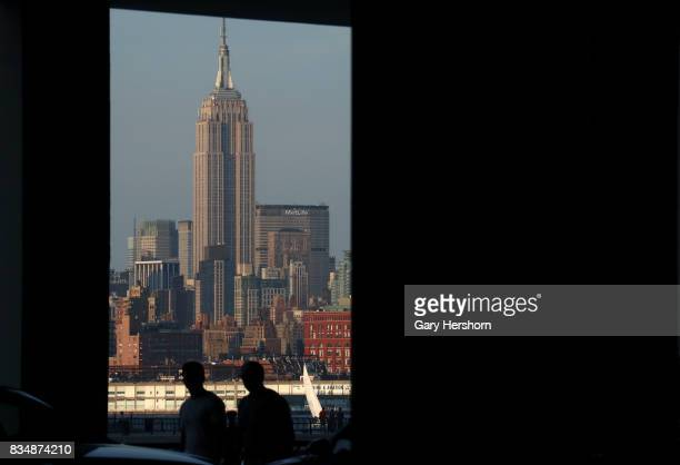 Sunset falls on midtown Manhattan and the Empire State Building in New York City on August 17 as seen from Jersey City New Jersey