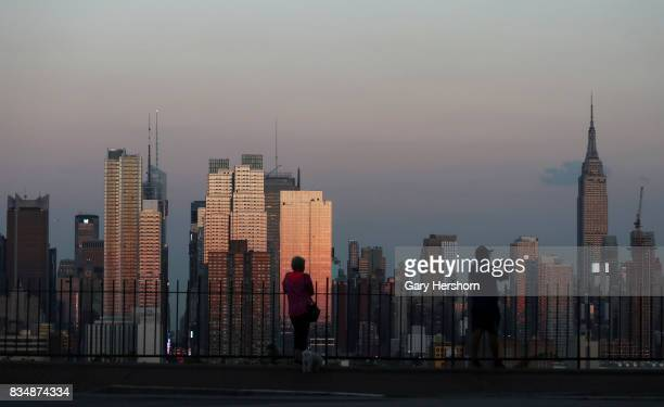 Sunset falls on midtown Manhattan and the Empire State Building in New York City on August 16 as seen from Weehawken New Jersey