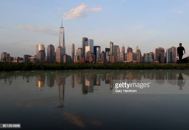 Sunset falls on One World Trade Center in New York City on June 18 as seen from Liberty State Park in Jersey City NJ