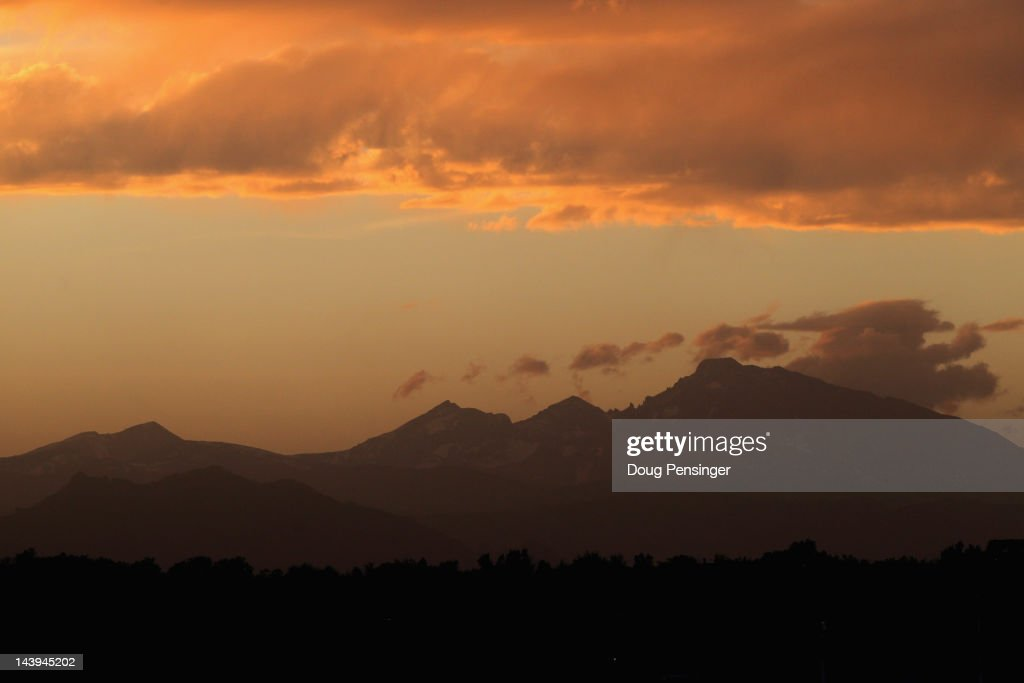 Sunset falls over the Rocky Mountains as a backdrop to the stadium as the Atlanta Braves face the Colorado Rockies at Coors Field on May 5 2012 in...