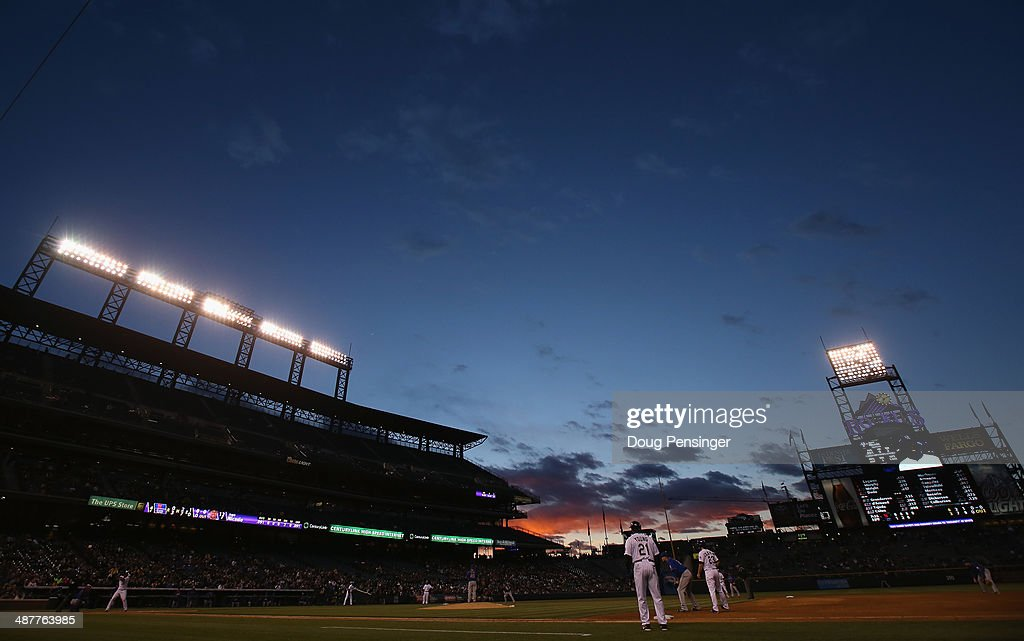 Sunset falls over the stadium as the New York Mets face the Colorado Rockies at Coors Field on May 1, 2014 in Denver, Colorado. The Rockies defeated the Mets 7-4.