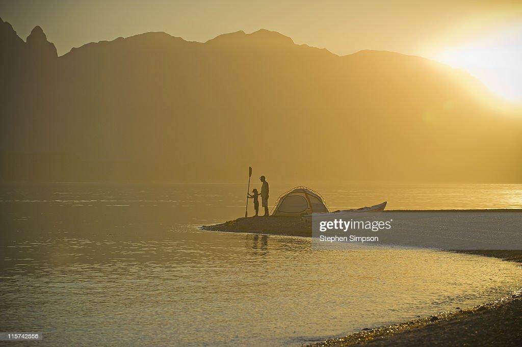 sunset, father & son beach camping w/kayak : Stock Photo