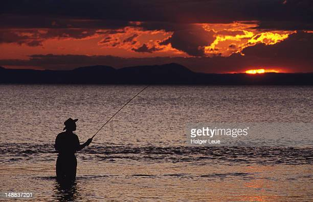 Sunset fishing on Lake Taupo, near Taupo.
