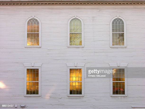 Sunset glow behind church windows