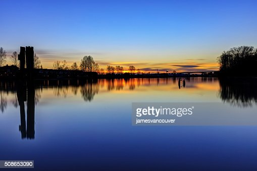 Sunset glow over river : Stock Photo