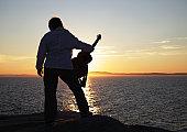 Sunset Guitar Woman