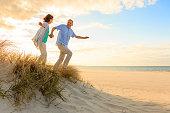 Sunset – happy mature couple at beach