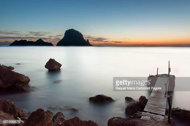Sunset in Cala d´Hort with Es Vedrá islet at the back