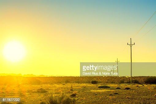 Sunset in desert landscape : ストックフォト