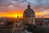 Sunset with a view over the skyline of Granada with the beautiful dome of La Merced church, Nicaragua, Central America.