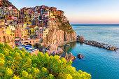 Sunset in Manarola, Cinque Terre, Italy. Amazing town in the italian mediterranean sea coast.