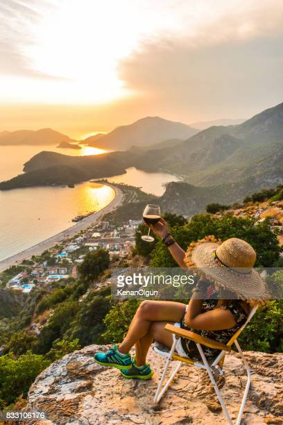Sunset in oludeniz. The woman who drinks wine. Cheers.