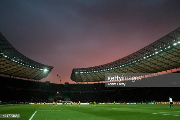 Sunset is pictured over the Olympic stadium during the DFB Cup Final match between Borussia Dortmund and FC Bayern Muenchen at Olympiastadion on May...
