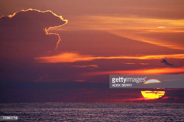 Sunset is seen from the KRI Fatahillah as the ship along with USNS Mary Sears takes part in an ongoing search operation for the missing Adam air...