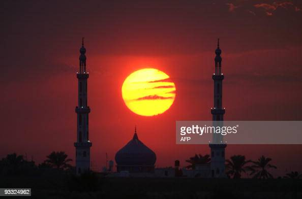 A sunset is seen through the minarets of a mosque along the IsraeliGaza Strip border 17 October 2007 An Israeli soldier and Palestinian militant were...