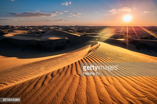 Sunset, Kubuqi Desert, near Erdos, Inner Mongolia, China.