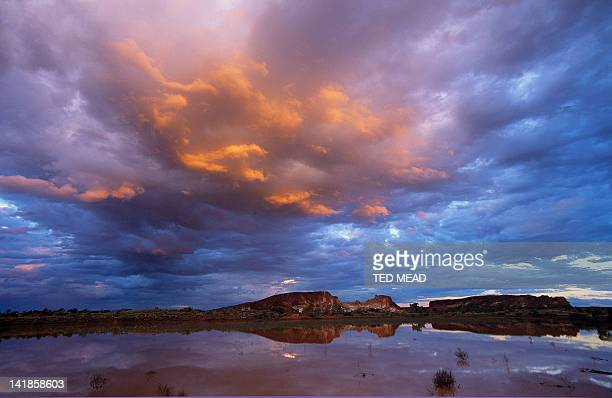 Sunset on a flooded claypan in Rainbow Valley Conservation Area, Northern Territory, Australia.
