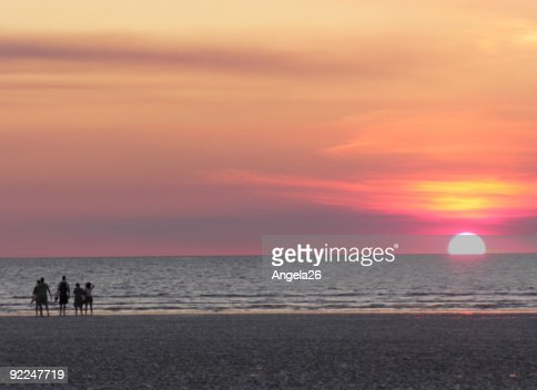Sunset on beach with pink sky