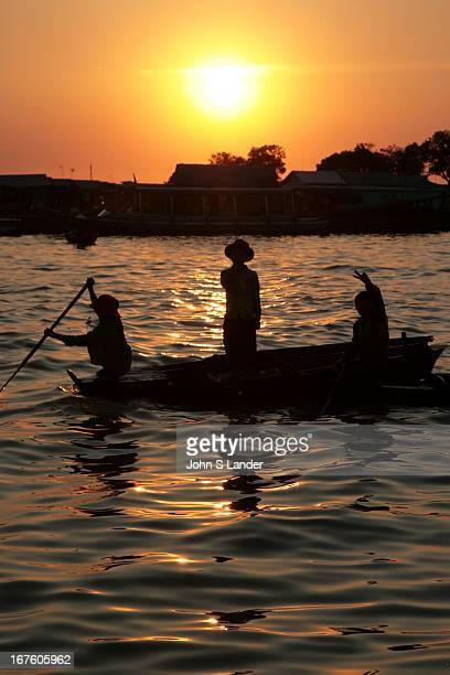 Sunset on the Tonle Sap which is a combined lake and river system of huge importance to Cambodia The area is home to many ethnic Vietnamese and...
