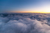 Flying above the clouds at sunset. view from the airplane window