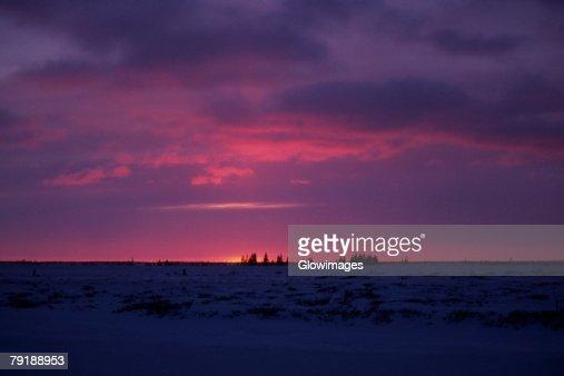 Sunset over a frozen landscape, Churchill, Manitoba, Canada : Foto de stock