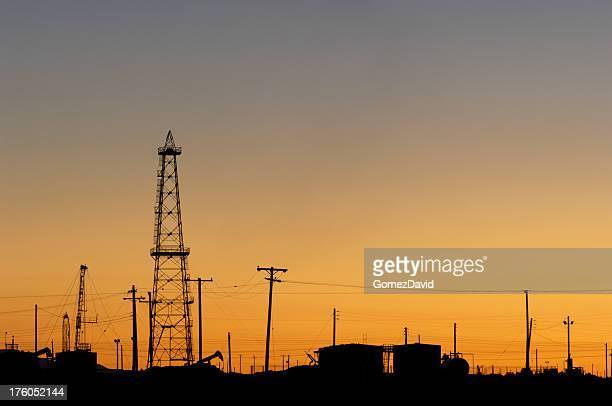 Sunset  over a oil field in California