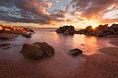 Sunset over a secluded beach in Coles Bay, Freycinet national Park, Tasmania, Australia