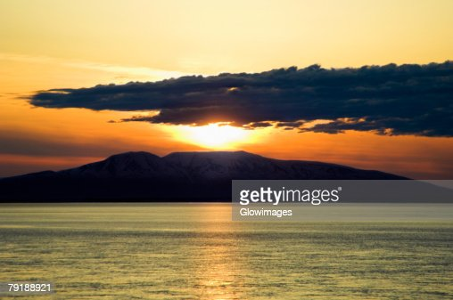 Sunset over an island, Fire Island, Alaska, USA : Foto de stock