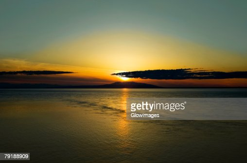 Sunset over an island, Fire Island, Anchorage, Alaska, USA : Foto de stock