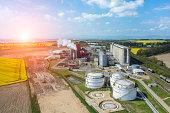 Beautiful sunset over the modern biofuel factory