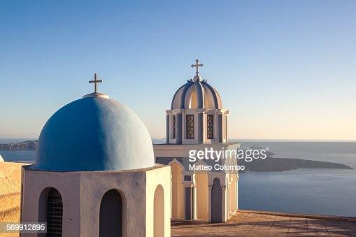 Sunset over blue domed churches in Santorini