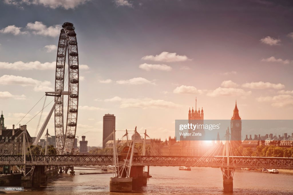Sunset over bridge and London Eye : Stock Photo