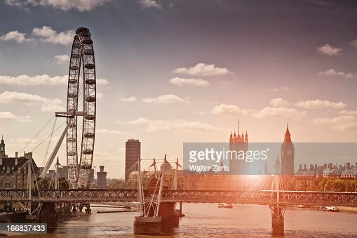 Sunset over bridge and London Eye : ストックフォト