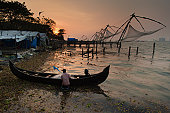Sunset over Chinese fishing nets in Fort Kochi