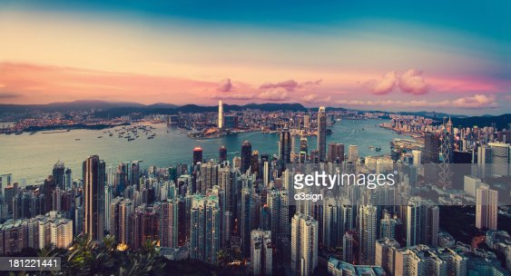 Sunset over city skyline and Victoria Harbour